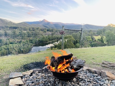 Keep warm around the firepit with a stunning backdrop
