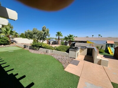 huge back yard basketball court miniature golf BBQ swimming pool and jacuzzi and