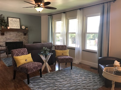 Enjoy our unique living room with TWO cozy gathering areas to visit!