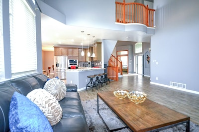 """This spacious family room has a  65"""" flat screen smart HD television."""