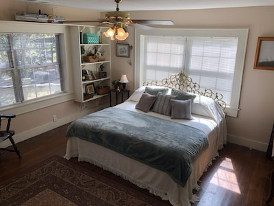 Master bedroom features a king size brass bed