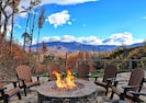 Enjoy the mountain views sitting next to the huge fire pit