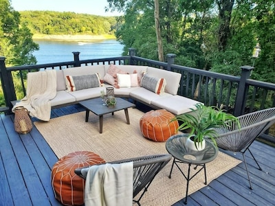 Catch up with friends and family on the deck nestled amongst mature trees over looking Iowa river and Sugar Bottom State Park