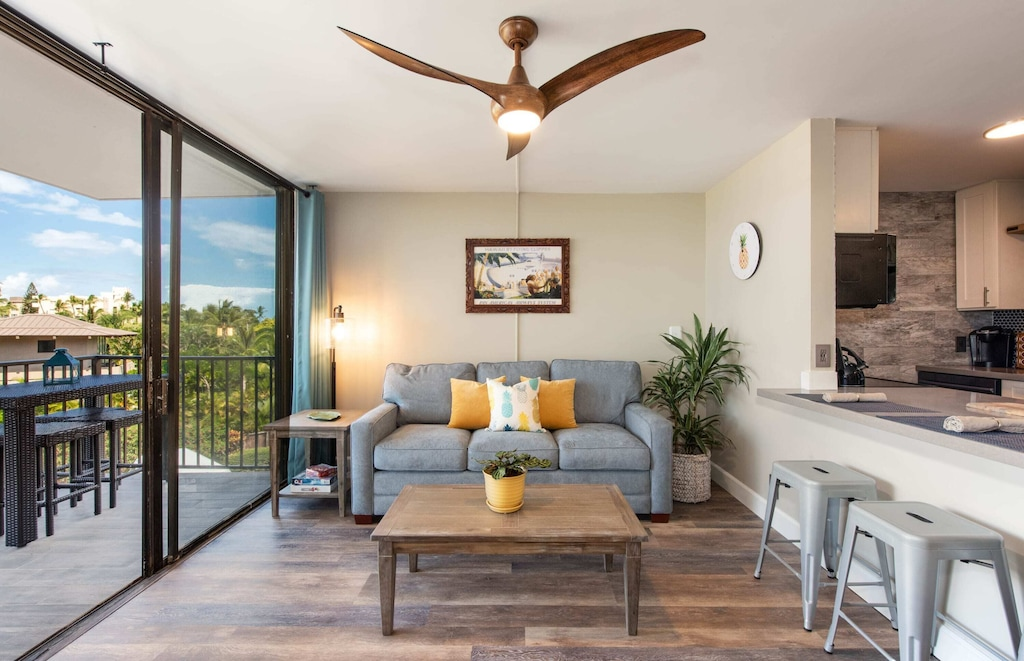 Kihei condo's soft-toned interior and grey couch