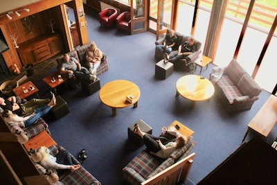 Relaxing in the lounge at Valhalla Lodge with afternoon drinks