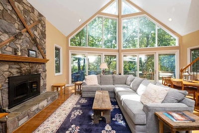 Luxurious Wintergreen Home with gorgeous wall of windows on main level.