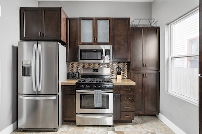 Plenty of cabinet space to bring food for your stay, and a fully equipped kitchen with all of the utensils you'd need to make a home-cooked meal.