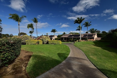 Lush tropical landscaping throughout the property.