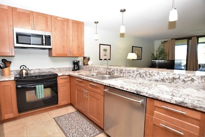 Completely renovated kitchen is stocked with everything you need for cooking.