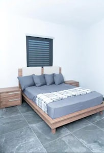 Spacious Bedroom with queen sized bed and attached bathroom.