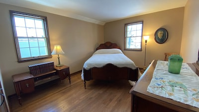 Master Bedroom with vintage furniture and new mattress.