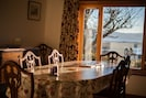 Dining room with a view. Sits 8 people comfortably. Picture taken in Winter
