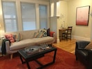 Relax, enjoy TV time, read a book on the living/ dining room/ office area space.