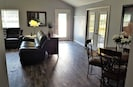 Entrance into the living room. Double doors leading to outdoor patio & gas grill