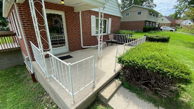 The cute front porch greets you as you walk up the driveway.