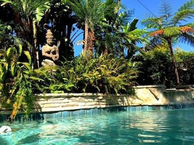 Balinese Goddess watching the pool