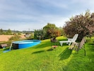Cloud, Plant, Sky, Green, Natural Landscape, Azure, Natural Environment, Shade, Outdoor Furniture, Land Lot