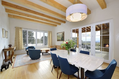 Open space dining and living area - patio doors to portico with outside seating