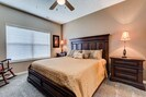 Master bedroom with King bed and rocking chair