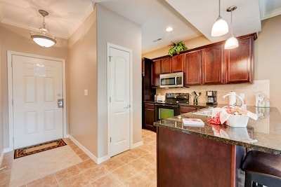 Front door & foyer; fully-furnished kitchen