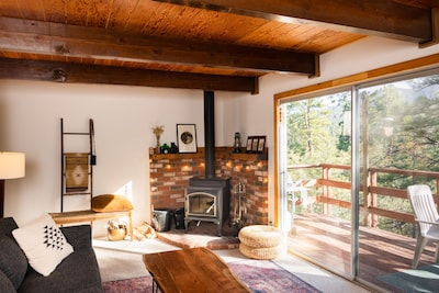 Living room with cozy fireplace. - Living room with cozy fireplace.