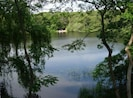 View of Schoolhouse Pond from deck with comfortable, casual seating.