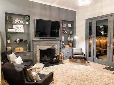 Wood burning fireplace and TV gives you options for in home enjoyment.