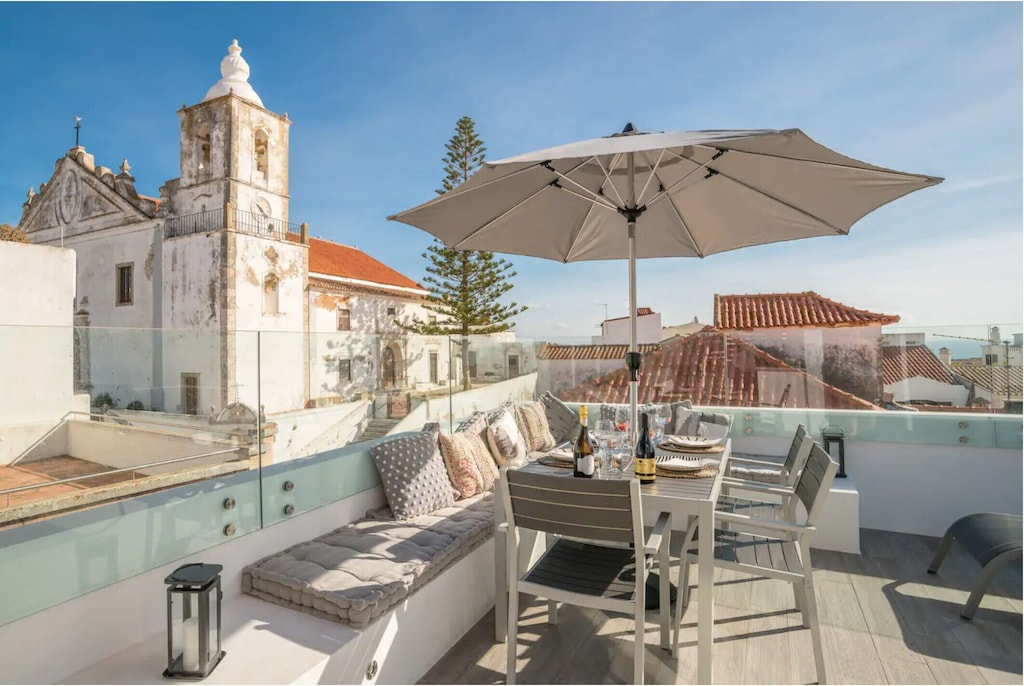 Terrace with umbrella overlooking the old town of Lagos Portugal
