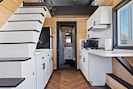 The cool, modern open floor design is what makes Lotus the Ultimate Tiny Home.