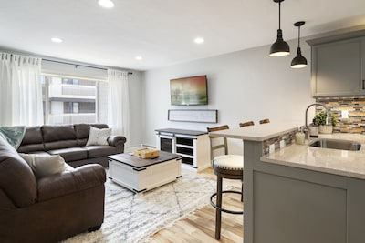 The open-concept kitchen leading in to the living room with a full sectional.