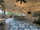Visit and watch your favorite sports on the huge screened porch.