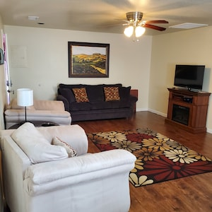 Living Room with sleeper sofa and 2 arm chairs