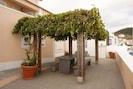 Enjoy meals under the shade of the vine pergola