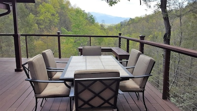 Dining area on main floor deck overlooking the mountain view