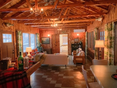 Great Room with original knotty pine and copper light fixtures