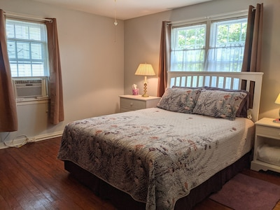 Bedroom 2 with queen size select comfort bed and window unit a/c.