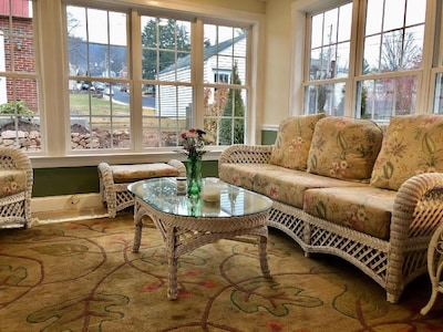 Sunroom with a view of the backyard.
