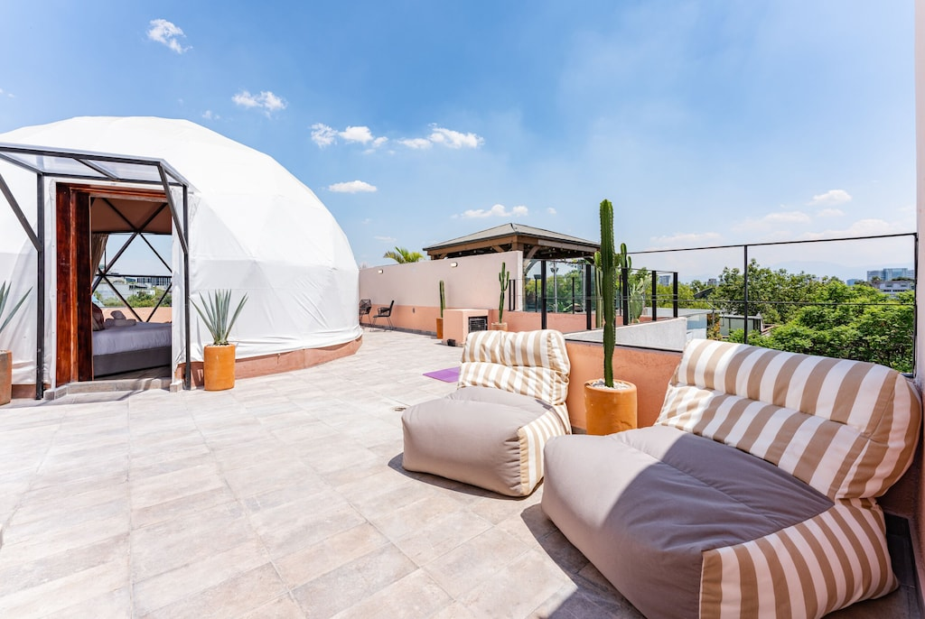 VRBO Mexico City: Geodesic dome apartment rental outdoor lounge seating on a rooftop