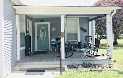 Large front porch is perfect for relaxing with book or cup of coffee
