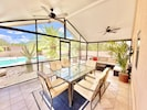Arizona Sunroom surrounded by desert landscape. Enjoy outdoor meals and relaxing