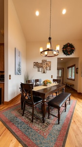 Vaulted Ceiling Dining Area in Great Room with space to expand table.
