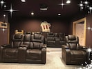Leather reclining theater room chairs with big screen, plus 4 bean bag chairs