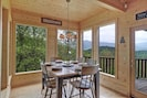 Eating area off kitchen and living room on main floor overlooking that view!!