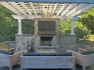Shared outdoor fireplace with Fios TV and Bose system