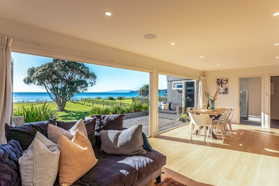 Open plan living and dining onto large Deck with seaview