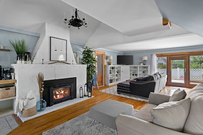 Cozy loveseat situated in front of the fireplace