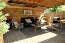 A wonderful covered private patio to relax in to get that outdoor feeling.
