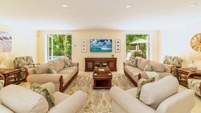 The living room features ample comfortable seating...