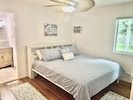 Master bedroom with king bed and ensuite bath