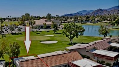 Aerial view of home with golf course, lake, clubhouse and mountains